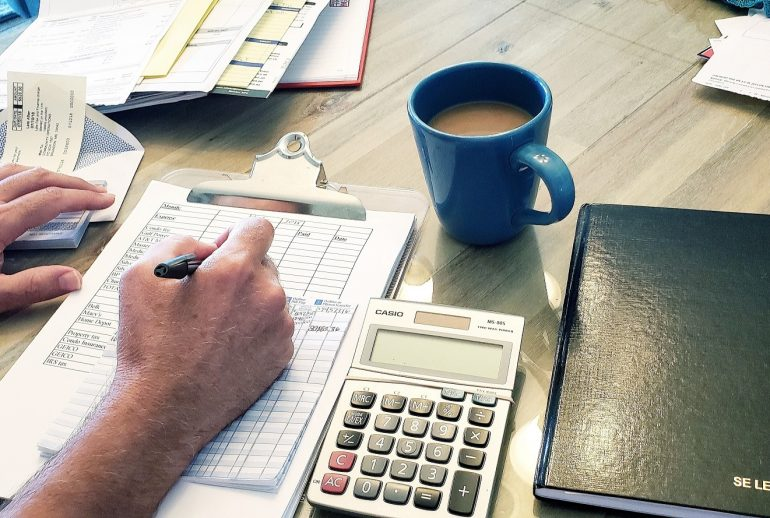 man-in-his-home-office-which-happens-to-be-dining-room-table-coffee-coffee-cup-work-working-working_t20_eo407o